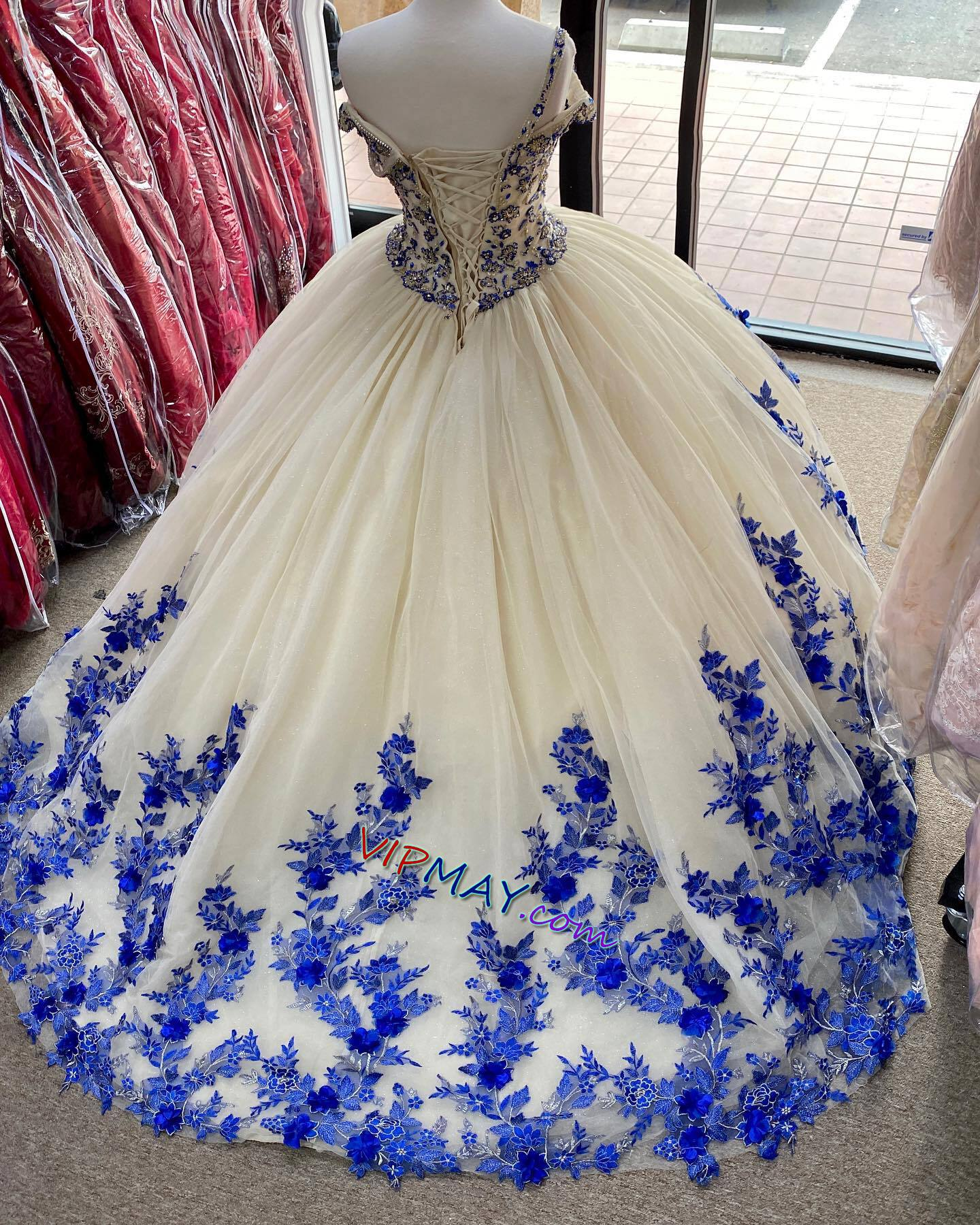 champagne colored quinceanera dress,in royal blue quinceanera dress,tulle skirt quinceanera dress,3d floral applique quinceanera dress,beaded bodice quinceanera dress,off shoulder quinceanera dress,2021 quinceanera dress,stores that sell quinceanera dress,cheap quinceanera dress stores,