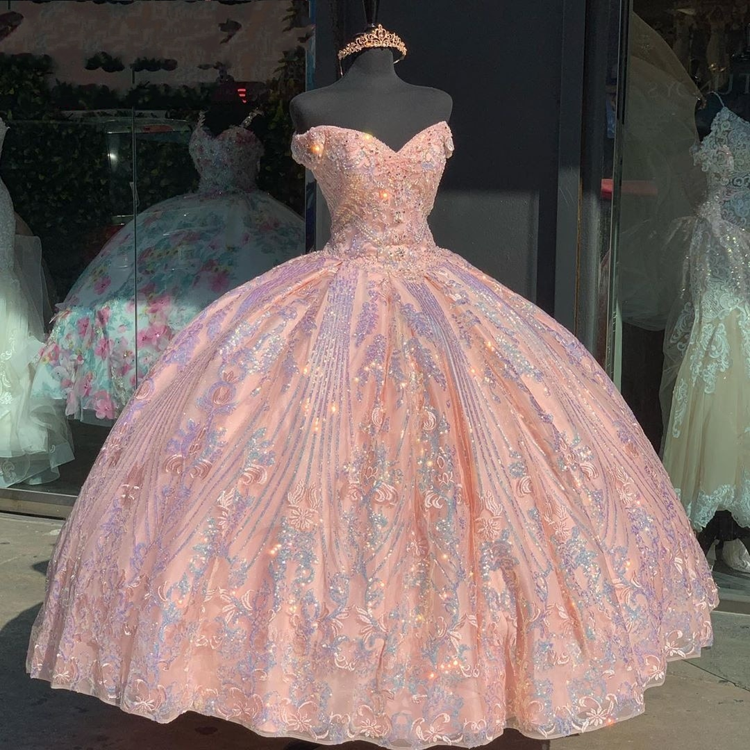 ready to ship quinceanera dresses,sparkly quinceanera dress,full sequin pageant dress for teenage girl,sequin ball gown charro quinceanera dress,cap sleeves quinceanera dress,2021 quinceanera dress,pink ball gown quinceanera dress,strapless sweetheart quinceanera dress,