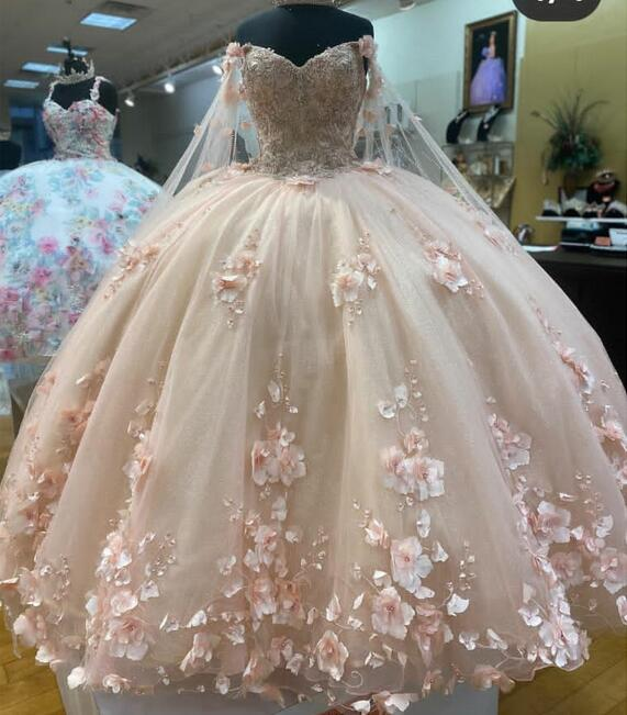 off the shoulder quinceanera dress,champagne colored quinceanera dress,quinceanera dress with cape,glitter houston quinceanera dress,glitter cape quinceanera dress,2021 quinceanera dress,blush pink quinceanera dress,quinceanera dress with 3d flowers,3d floral applique quinceanera dress,